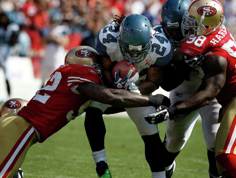 Marshawn Lynch finds it tough going in the first half against the 49er defense. The San Francisco 49ers defeat the Seattle Seahawks 33-17 at Candlestick Park Sunday September 11, 2011. Photo: Brant Ward, The Chronicle / ONLINE_YES