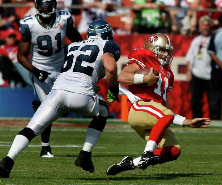 Alex Smith slid after a run in the first half. The San Francisco 49ers defeat the Seattle Seahawks 3