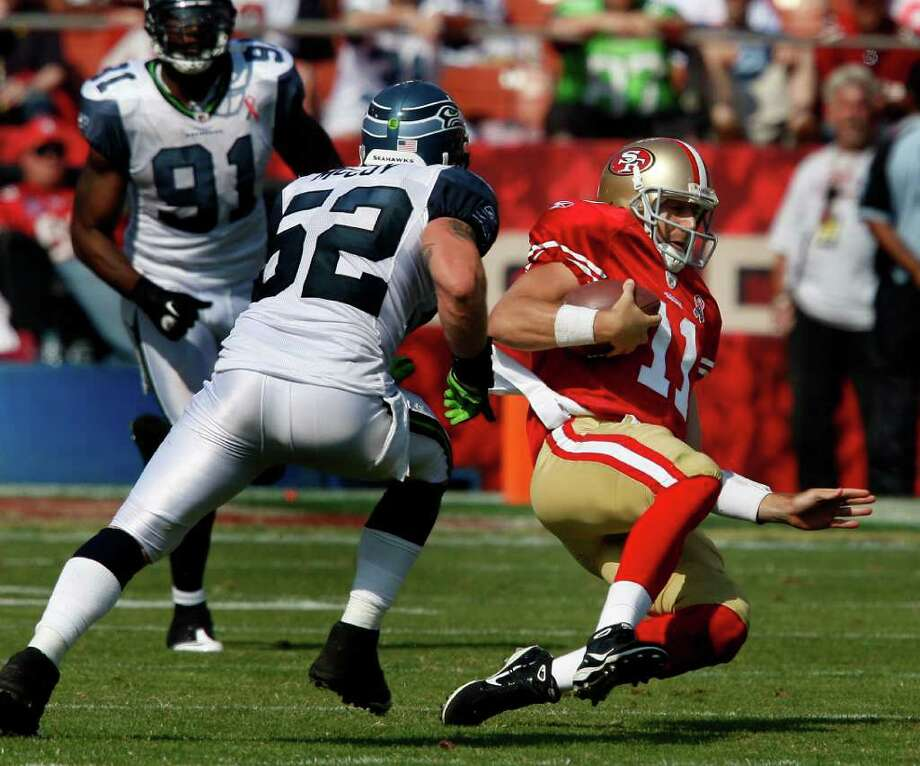 Alex Smith slid after a run in the first half. The San Francisco 49ers defeat the Seattle Seahawks 33-17 at Candlestick Park Sunday September 11, 2011. Photo: Brant Ward, The Chronicle / ONLINE_YES