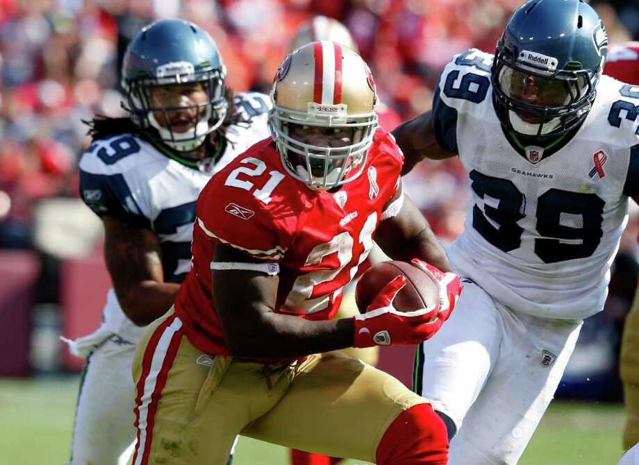 Frank Gore got through the defense in this second half action. The San Francisco 49ers defeat the Seattle Seahawks 33-17 at Candlestick Park Sunday September 11, 2011. Photo: Brant Ward, The Chronicle / ONLINE_YES
