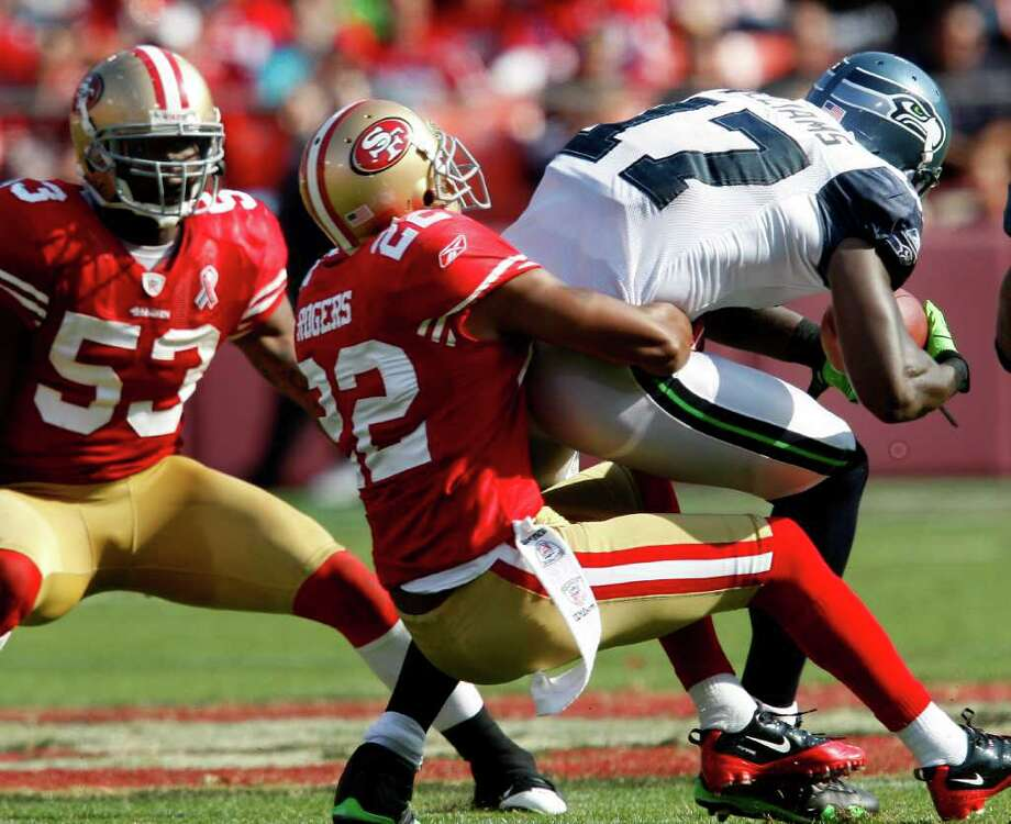 Carlos Rogers takes down Mike Williams after a short pass in the first half. The San Francisco 49ers defeat the Seattle Seahawks 33-17 at Candlestick Park Sunday September 11, 2011. Photo: Brant Ward, The Chronicle / ONLINE_YES