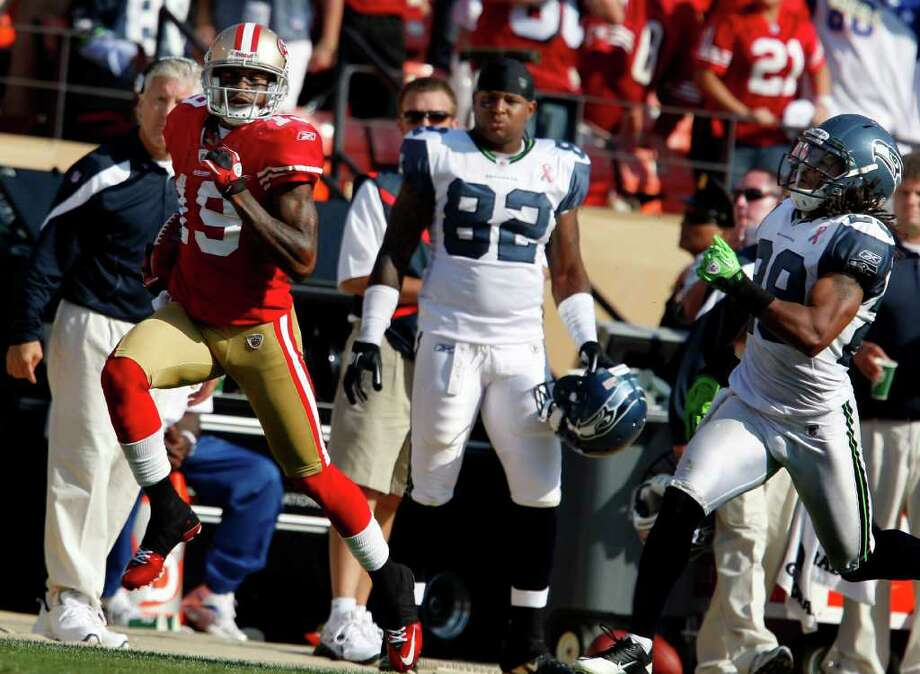 Ted Ginn Jr. races down the sideline for his first runback touchdown. The San Francisco 49ers defeat the Seattle Seahawks 33-17 at Candlestick Park Sunday September 11, 2011. Photo: Brant Ward, The Chronicle / ONLINE_YES