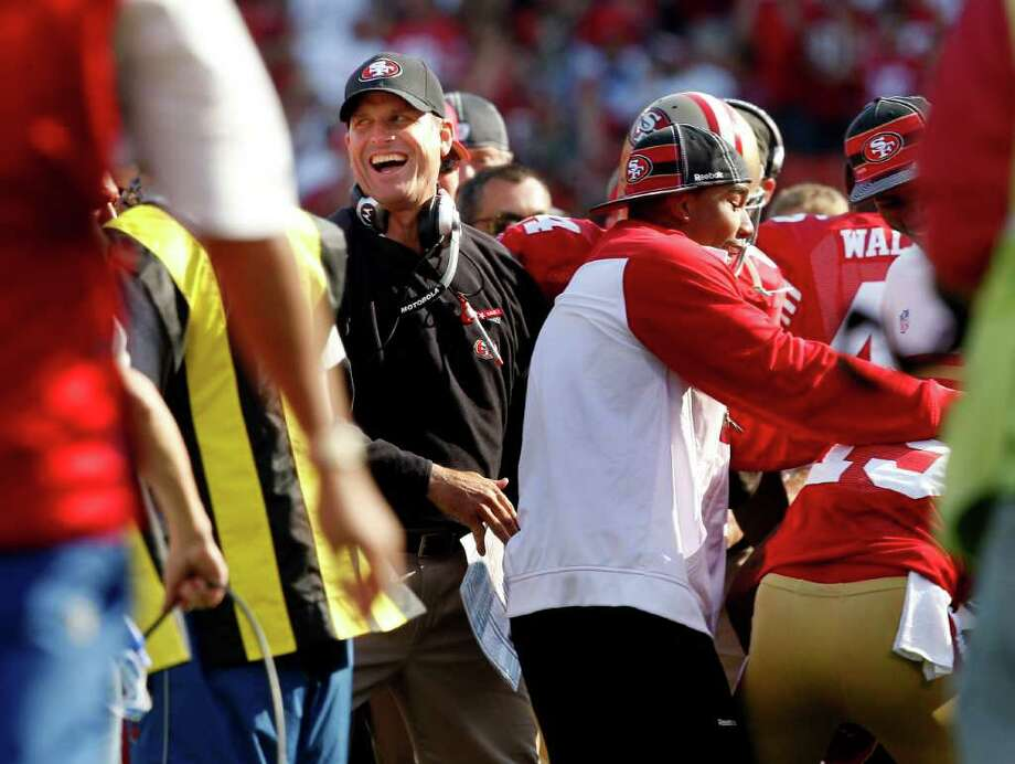 49ers head coach Jim Harbaugh enjoys the final minutes of the game. The San Francisco 49ers defeat the Seattle Seahawks 33-17 at Candlestick Park Sunday September 11, 2011. Photo: Brant Ward, The Chronicle / ONLINE_YES
