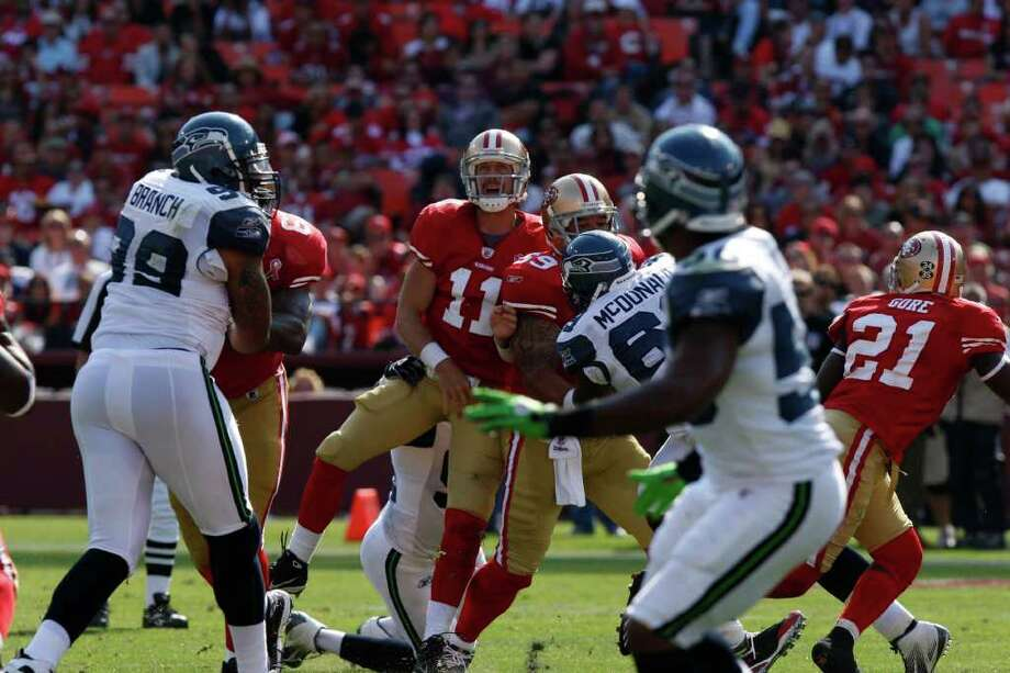 San Francisco quarterback Alex Smith watches his pass during the fourth quarter of the San Francisco 49ers vs. Seattle Seahawks game at Candlestick Park in San Francisco, Calif. on Saturday, Sept. 10, 2011. Photo: Dylan Entelis, The Chronicle / ONLINE_YES