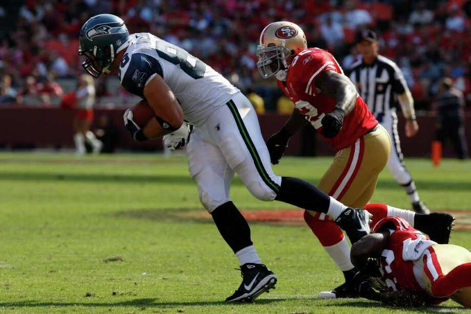 Seattle Seahawks tight end Zach Miller stretches for more yards during the San Francisco 49ers vs. Seattle Seahawks game at Candlestick Park in San Francisco, Calif. on Saturday, Sept. 10, 2011. Photo: Dylan Entelis, The Chronicle / ONLINE_YES