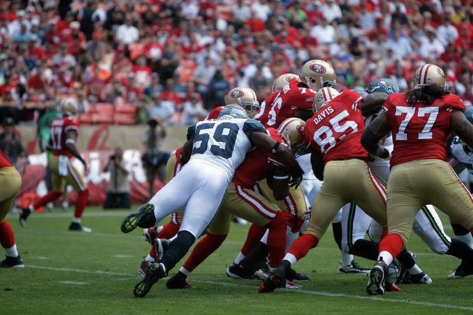 Seattle Seahawks linebacker Aaron Curry tackles the ball carrier during the first quarter of the San Francisco 49ers vs. Seattle Seahawks game at Candlestick Park in San Francisco, Calif. on Saturday, Sept. 10, 2011. Photo: Dylan Entelis, The Chronicle / ONLINE_YES