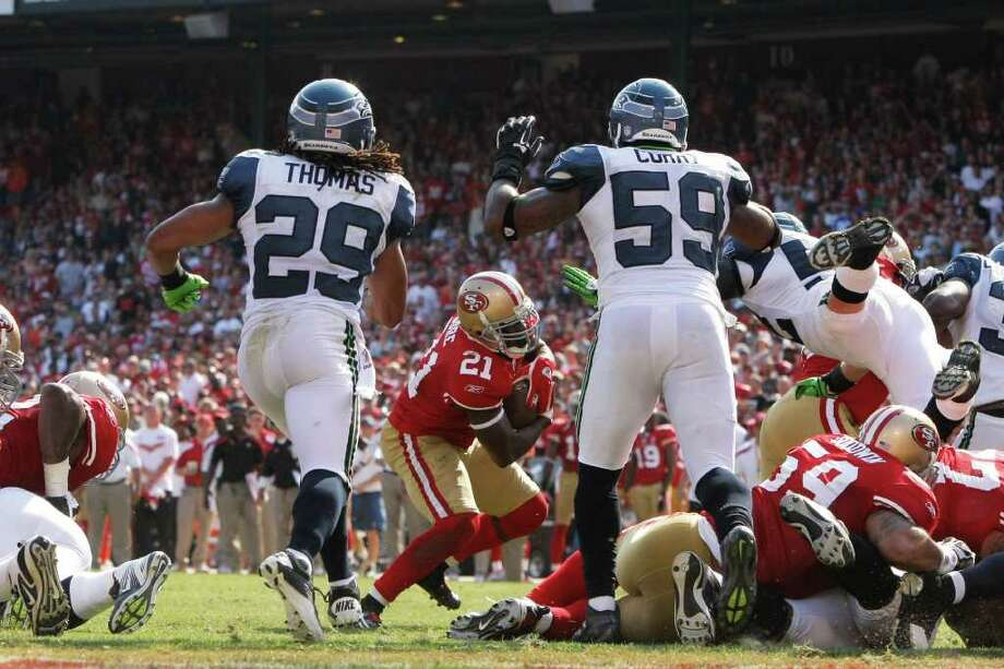 San Francisco 49ers running back Frank Gore rushes towards the pile during the fourth quarter of the San Francisco 49ers vs. Seattle Seahawks game at Candlestick Park in San Francisco, Calif. on Saturday, Sept. 10, 2011. Photo: Dylan Entelis, The Chronicle / ONLINE_YES