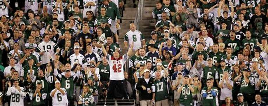 Fireman Ed Anzaloni cheers with New York Jets fans during the second half of an NFL football game between the Dallas Cowboys and the Jets Sunday, Sept. 11, 2011,  in East Rutherford, N.J. (AP Photo/Julio Cortez) Photo: Associated Press