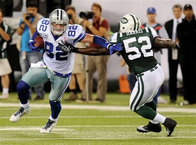New York Jets linebacker David Harris (52) attempts to stop Dallas Cowboys tight end Jason Witten (82) during the first half of an NFL football game Sunday, Sept. 11, 2011,  in East Rutherford, N.J. (AP Photo/Henny Ray Abrams) Photo: Associated Press