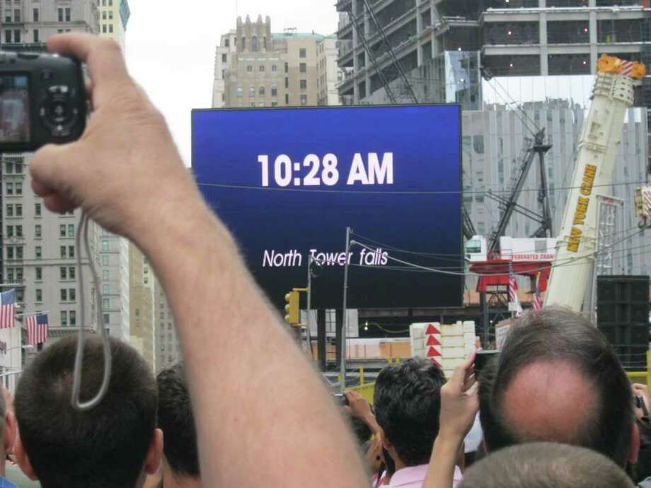 Thousands of mourners pause at the moment that the north tower fell on the 10th anniversary of 9/11 Sunday, Sept. 11, 2011 near ground zero of the World Trade Center in New York City.  (Paul Grondahl/Times Union) Photo: Paul Grondahl