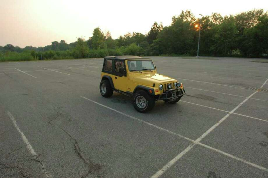 Christopher Porco's distinctive yellow Jeep was a crucial part of the prosecution's case. Surveillance cameras captured the Jeep leaving a Rochester college the night of his father's murder. Two toll collectors also recalled seeing a similar Jeep around the time prosecutors said Porco drove home on the NYS Thruway with a plan to kill his parents. The Jeep is pictured here outside an Orange County courthouse a couple hours after Porco was convicted. (Michael P. Farrell/Times Union) Photo: MICHAEL P. FARRELL / ALBANY TIMES UNION