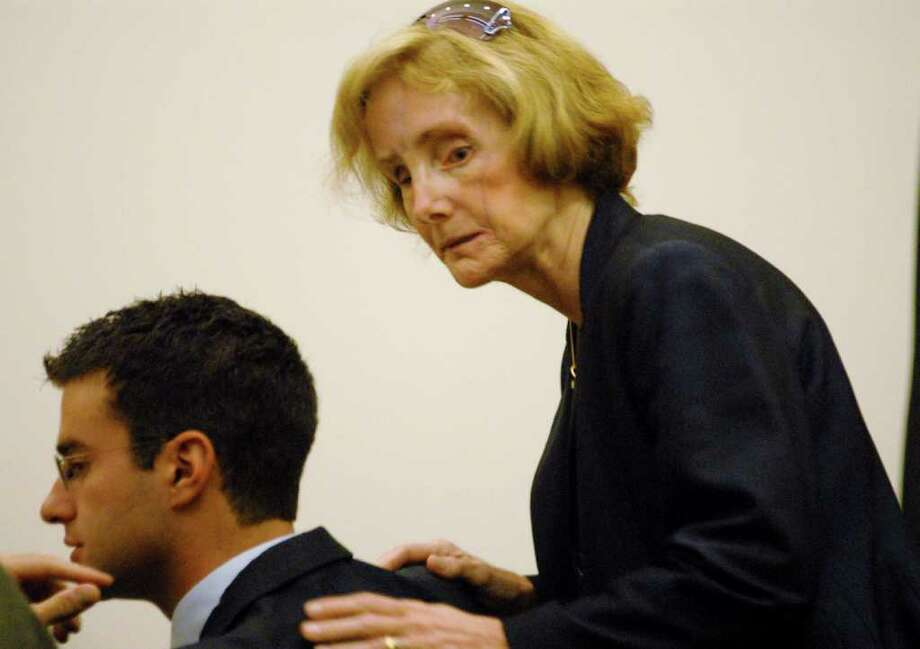 Joan Porco, right, comforts her son, Christopher Porco, near the end of his murder trial in the Orange County Courthouse in Goshen, N.Y., Thursday, Aug. 3, 2006. Joan Porco attended the trial daily in support of her son. (Times Union/Michael P. Farrell, Pool) Photo: MICHAEL P. FARRELL / POOL ALBANY TIMES UNION