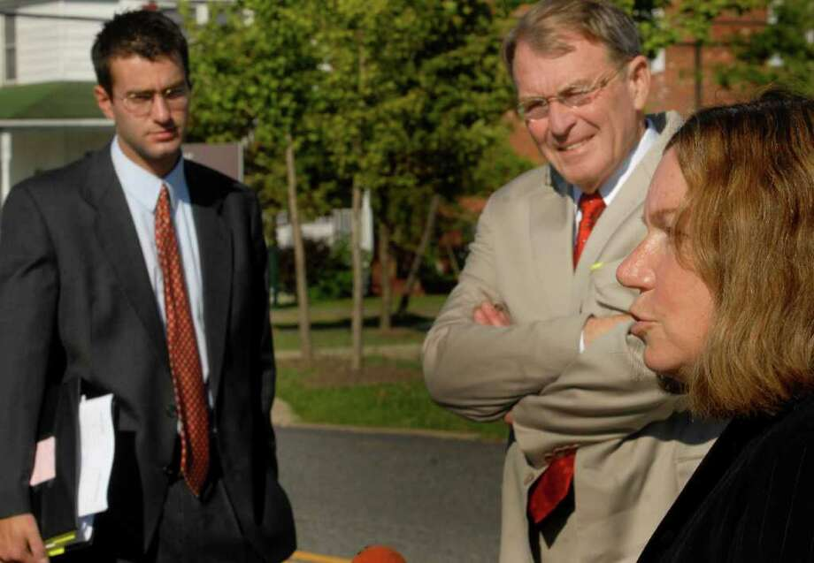 Christopher Porco, left, looks on as his attorneys, Laurie Shanks, right, and Terence L. Kindlon talk during a break in Porco's murder trial in Goshen, Orange County. (Times Union/Michael P. Farrell) Photo: MICHAEL P. FARRELL / ALBANY TIMES UNION