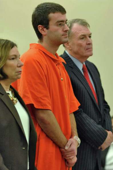 Christopher Porco, center, stands next to his attorneys, Laurie Shanks and Terence L. Kindlon, as he