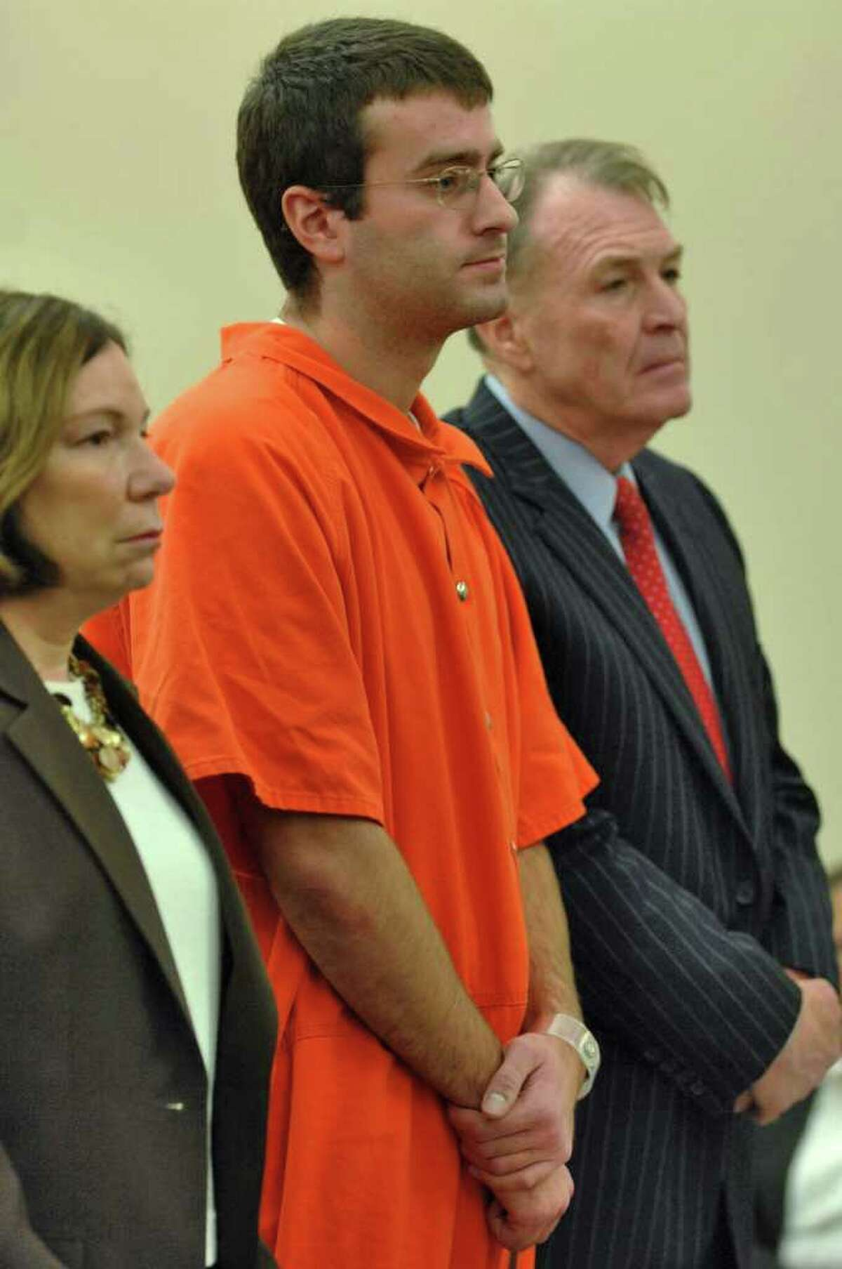 Christopher Porco, center, stands next to his attorneys, Laurie Shanks and Terence L. Kindlon, as he is sentenced in December 2006 to 46 years to life in prison for the murder of his father and the attempted murder of his mother. (Times Union/Philip Kamrass)