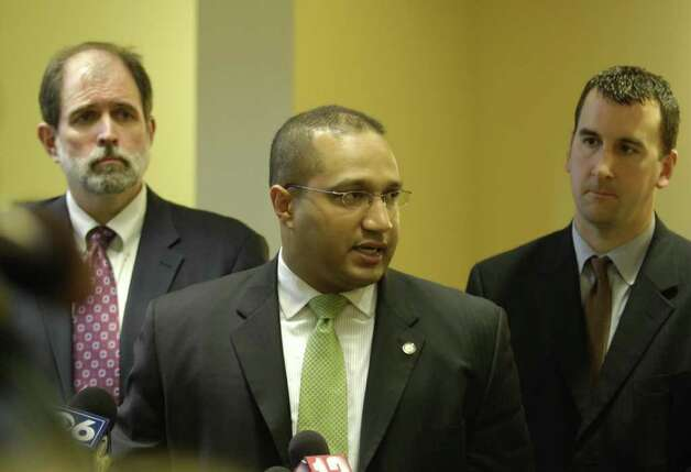 Albany County District Attorney David Soares, center, speaks to the press after Christopher Porco's sentencing at the Albany County Courthouse in Albany, New York today December 12, 2006.  He is flanked by the case prosecutors, former assistant District Attorney Michael McDermott, left, and David Rossi, right. If Porco's appeal is successful Rossi would again be the prosecutor. (Times Union/Skip Dickstein) Photo: SKIP DICKSTEIN / ALBANY TIMES UNION