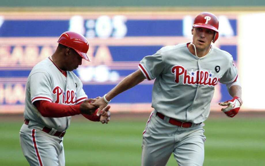 MILWAUKEE, WI - SEPTEMBER 10:  Hunter Pence #3 of the Philadelphia Phillies celebrates his home run with third base coach Jaun Samuel #12 during game action against the Milwaukee Brewers at Miller Park on September 10, 2011 in Milwaukee, Wisconsin. The Phillies beat the Brewers 3-2.(Photo by Mark Hirsch/Getty Images) Photo: Mark Hirsch / 2011 Getty Images