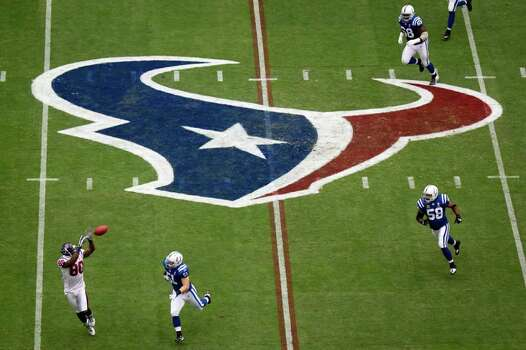 Houston Texans linebacker Mario Williams (90) makes a catch past Indianapolis Colts linebacker Pat Angerer (51) on the first play from scrimmage at Reliant Stadium. Photo: Smiley N. Pool, Houston Chronicle / © 2011  Houston Chronicle