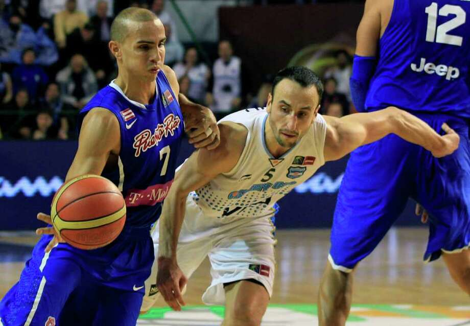 Puerto Rico's Carlos Arroyo, left, attempts to dribble past Argentina's Manu Ginobili during their FIBA Americas Championship semi-final basketball game in Mar del Plata, Argentina, Saturday Sept. 10, 2011. Photo: Martin Mejia/Associated Press