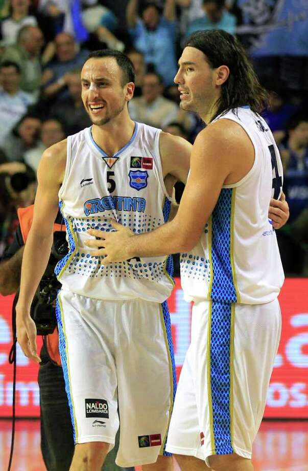 Argentina's Manu Ginobili, left, and teammate Luis Scola celebrate after defeating Puerto Rico 81-79 in their FIBA Americas Championship semi-final basketball game in Mar del Plata, Argentina, Saturday Sept. 10, 2011. Photo: Martin Mejia/Associated Press