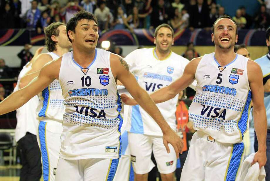 Argentina's Carlos Delfino, left, and teammate Manu Ginobili celebrate after defeating Puerto Rico 81-79 in their FIBA Americas Championship semi-final basketball game in Mar del Plata, Argentina, Saturday Sept. 10, 2011. Photo: Martin Mejia/Associated Press