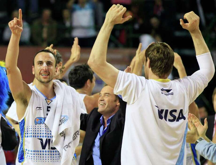 Argentina's Manu Ginobili, left, and teammate Andres Nocioni, right, celebrate their 81-79 over Puerto Rico in a FIBA Americas Championship semi-final basketball game in Mar del Plata, Argentina, Saturday Sept. 10, 2011. Photo: Martin Mejia/Associated Press
