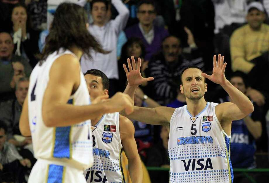 Argentina's Manu Ginobili, right, talks with his teammate Luis Scola, left, in their FIBA Americas Championship semi-final basketball game against Puerto Rico in Mar del Plata, Argentina, Saturday Sept. 10, 2011. Photo: Martin Mejia/Associated Press