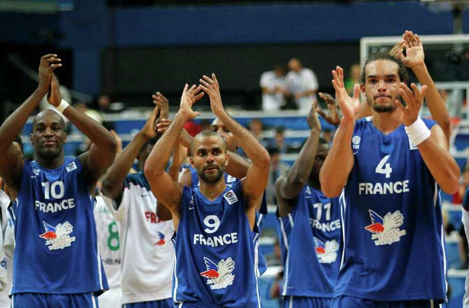 France's Tony Parker, center, Ali Traore, left, and Joakim Noah celebrate after their EuroBasket European Basketball Championship Group E match against Lithuania, in Vilnius, Lithuania, Friday Sept. 9, 2011. Photo: Darko Vojinovic/Associated Press / AP