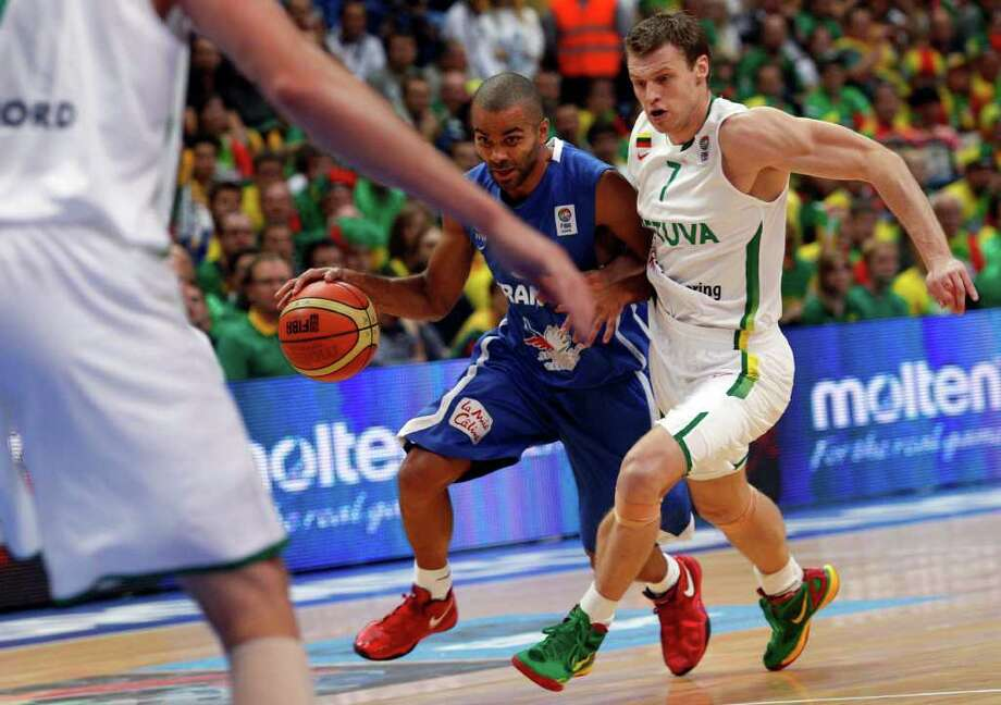 Tony Parker, left, of France is challenged by Martynas Pocius from Lithuania during the EuroBasket 2011, European Basketball Championships group E match between Lithuania and France  in Vilnius, Lithuania, on Friday, Sept. 9, 2011. Photo: Mindaugas Kulbis/Associated Press / AP