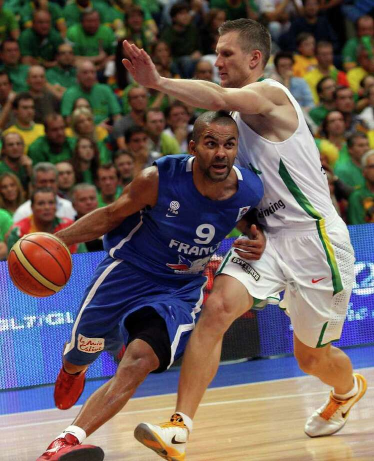 Tony Parker, left, of France is challenged by Rimantas Kaukenas from Lithuania during the EuroBasket 2011, European Basketball Championships group E match between Lithuania and France in Vilnius, Lithuania, on Friday, Sept. 9, 2011. Photo: Mindaugas Kulbis/Associated Press / AP