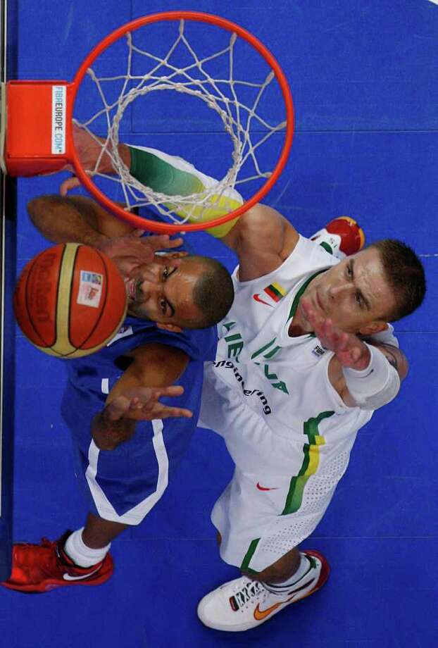 Tony Parker, left, from France fights for a ball with Robertas Javtokas, right, from Lithuania during the EuroBasket European Basketball Championship Group E match in Vilnius, Lithuania, Friday, Sept. 9, 2011. France won the match 73-67. Photo: Petr David Josek/Associated Press / AP