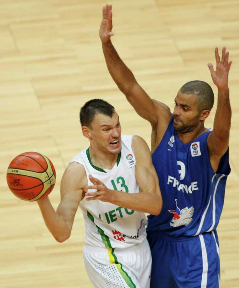 Tony Parker, right, from France guards Sarunas Jasikevicius, left, from Lithuania during the EuroBasket European Basketball Championship Group E match in Vilnius, Lithuania, Friday, Sept. 9, 2011. France won the match 73-67. Photo: Petr David Josek/Associated Press / AP