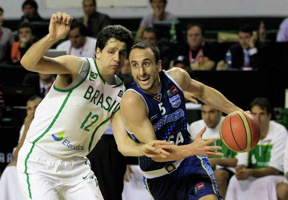 Argentina's Manu Ginobili, right, attempts to dribble past Brazil's Guilherme Giovannoni in their FIBA Americas Championship final basketball game in Mar del Plata, Argentina, Sunday Sept. 11, 2011. Photo: Martin Mejia/Associated Press