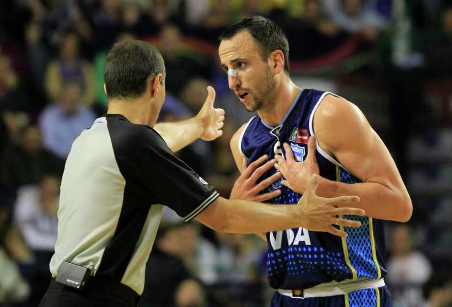 Argentina's Manu  Ginobili, talks to a referee during the FIBA Americas Championship final basketball game against Brazil in Mar del Plata, Argentina, Sunday Sept. 11, 2011. Photo: Martin Mejia/Associated Press