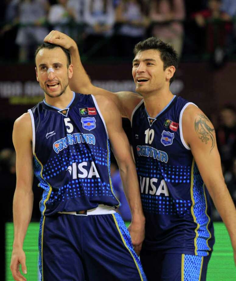 Argentina's Manu Ginobili, left, and Carlos Delfino celebrate their 80-75 victory over Brazil in their FIBA Americas Championship final basketball game in Mar del Plata, Argentina, Sunday Sept. 11, 2011. Photo: Martin Mejia/Associated Press