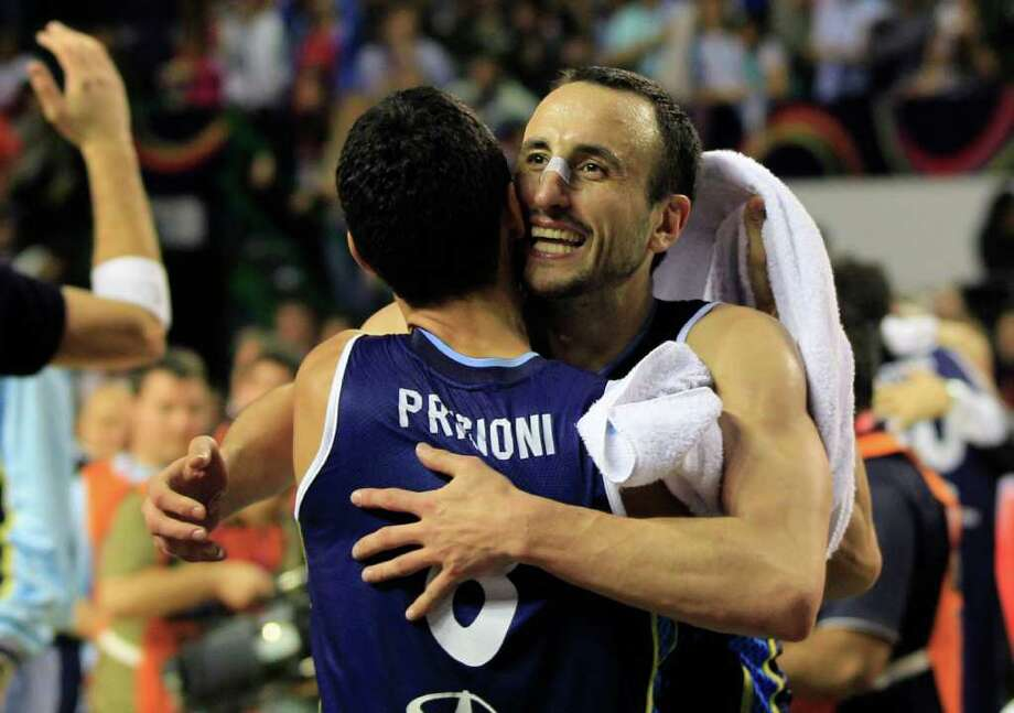 Argentina's Manu Ginobili, right, embraces teammate Pablo Prigioni in celebration of their 80-75 victory over Brazil in their FIBA Americas Championship final basketball game in Mar del Plata, Argentina, Sunday Sept. 11, 2011. Photo: Martin Mejia/Associated Press