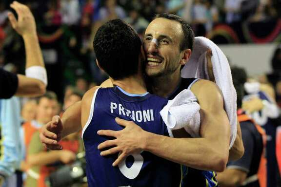 Argentina's Manu Ginobili, right, embraces teammate Pablo Prigioni in celebration of their 80-75 victory over Brazil in their FIBA Americas Championship final basketball game in Mar del Plata, Argentina, Sunday Sept. 11, 2011.