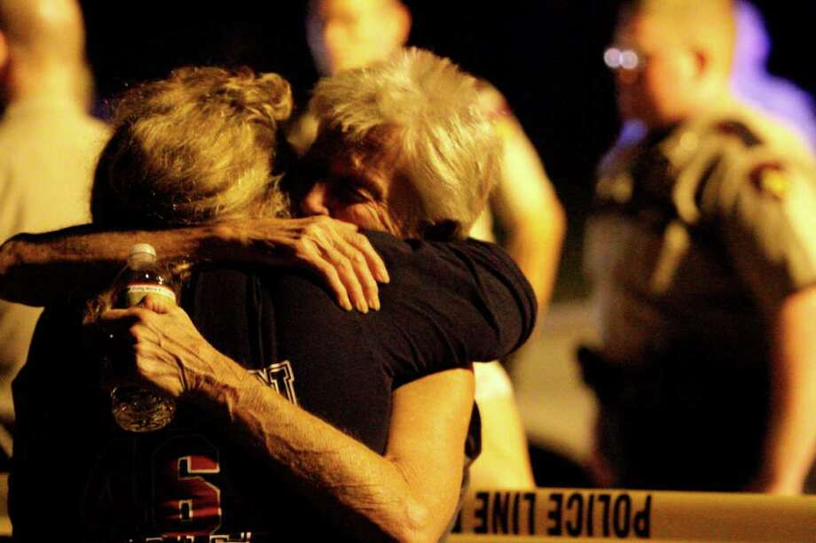 Members of the family of two brothers killed Sunday hold each other. Photo: Andrew Richardson, Staff / © 2011 Houston Chronicle