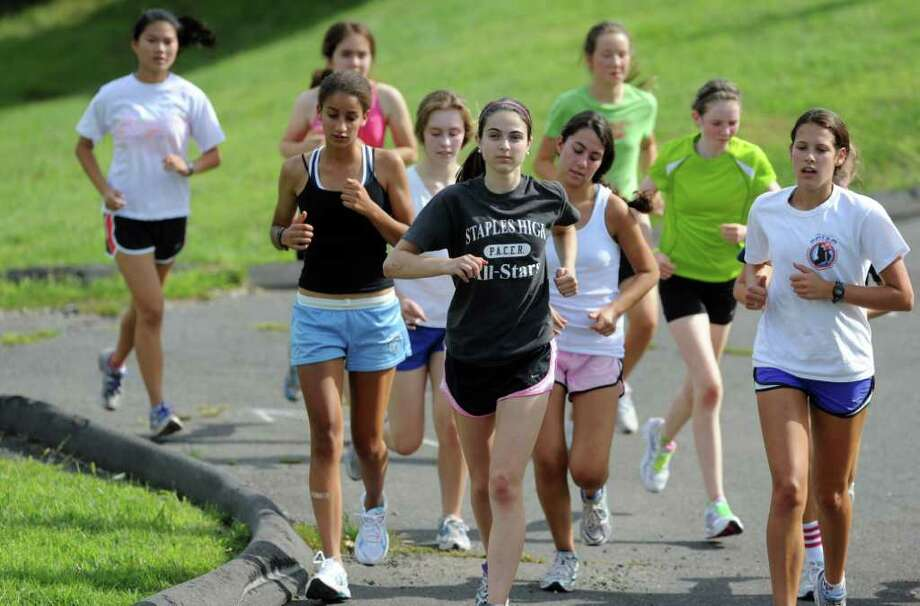 The Staples girls cross country team practices Wednesday, Aug. 31, 2011 at the school in Westport, Conn. Photo: Autumn Driscoll / Connecticut Post