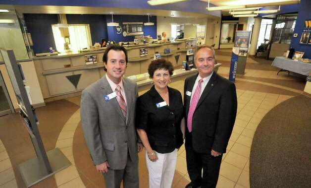 Brian Reklaitis, vice president branch manager, left; Lynne Sausto, branch manager, vice president; and Raymond Cirisoli, market manager vice president, stand in the Webster Bank branch at 83 Newtown Road in Danbury, Monday, Sept. 12, 2011. Photo: Michael Duffy / The News-Times