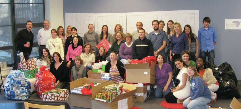 Every Higher One employee receives one paid Day of Service each year. Here, Higher One CARES works to Adopt A Family at the holidays. Photo: Contributed Photo