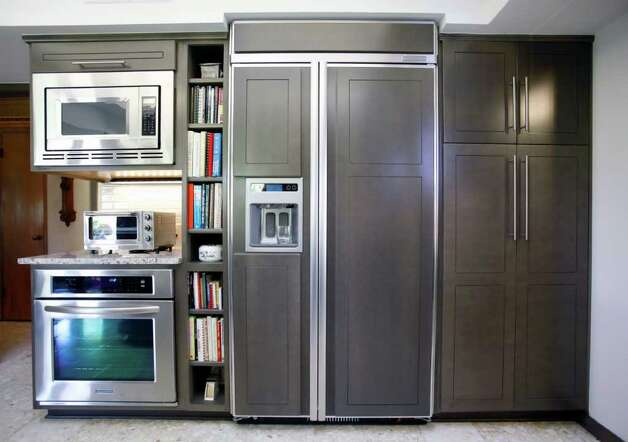 "Because their new fridge — which Dolly says ""fit through the front door with an eyelash to spare"" — is counter-depth, it doesn't hold as much it would seem. Photo: WILLIAM LUTHER, SAN ANTONIO EXPRESS-NEWS / 2011 SAN ANTONIO EXPRESS-NEWS"
