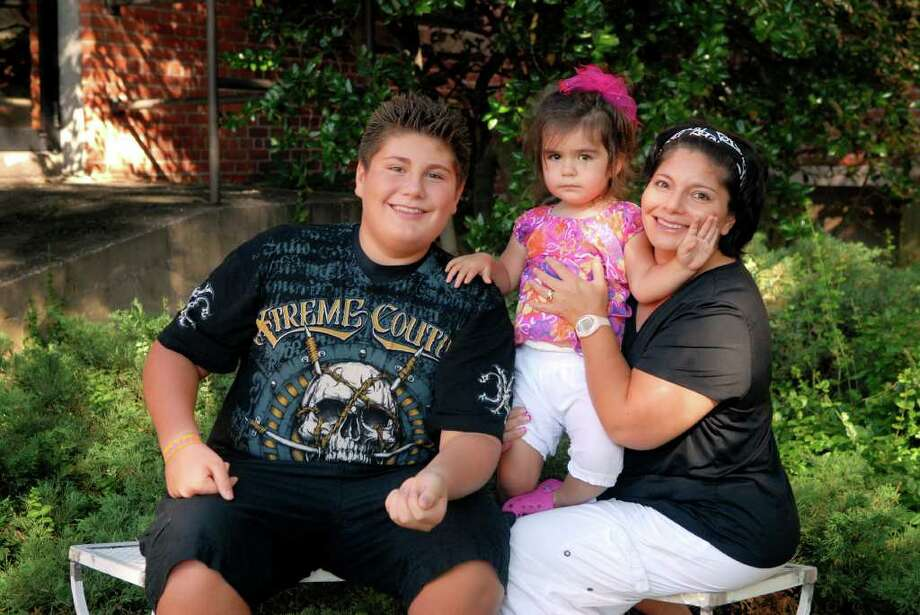 Cassandria Carlson and her children Daniel (13) and Lucianna (2) photographed in Stamford, Conn. on Friday September 9, 2011. Carlson claims to be the granddaughter of Lucille Ball and Desi Arnez. Photo: Dru Nadler / Stamford Advocate Freelance
