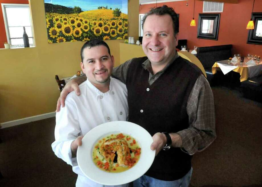 Chef Carlos Pineda, 32, left, and owner Angelo Marini, 46, in Sal e Pepe Resturant in Newtown, which is participating in Newtown Restaurant Week. Photo: Michael Duffy, ST / The News-Times