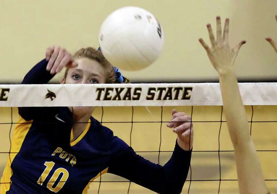 Poth's Avery Acker — seen here during a 2010 match — had 11 kills, 22 assists, 11 digs, five aces and 2½ blocks in a victory against New Braunfels Canyon, and eight kills, 12 assists and eight digs in a win against George West, nearly registering back-to-back triple-doubles. Photo: Kin Man Hui/kmhui@express-news.net / kmhui@express-news.net