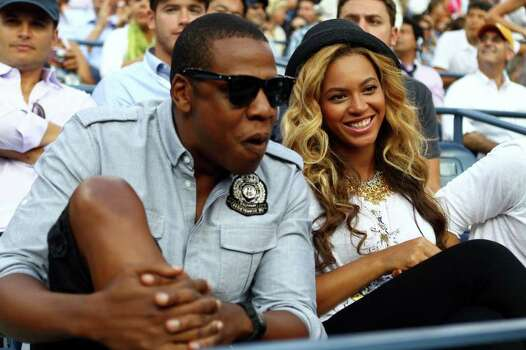 Recording artists Jay-Z and Beyonce watch Rafael Nadal of Spain and Novak Djokovic of Serbia play during the Men's Final of the 2011 US Open at the USTA Billie Jean King National Tennis Center in Flushing neighborhood of the Queens borough of New York City. Photo: Clive Brunskill, Getty / 2011 Getty Images