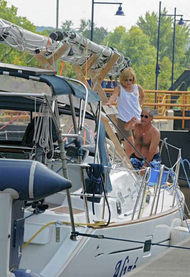Margaret and Dick Dragonette of Cleveland, OH due small repairs and clean on their sail boat docked at Lock 3 in Waterford, N.Y. Monday, Sept. 12, 2011. (Lori Van Buren / Times Union) Photo: Lori Van Buren