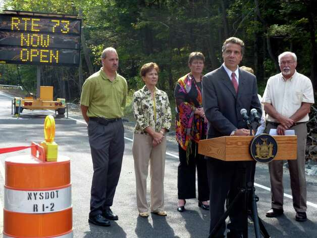 New York Gov. Andrew Cuomo speaks in St. HubertA'A's, N.Y. late Monday morning, Sept. 12, 2011, at a ceremony marking the reopening of state Route 73 from Keene Valley to Adirondack Northway Exit 30. Behind him, from left, are Essex County Board of Supervisors Chairman Randy Douglas, Assemblywoman Teresa Sayward, Deputy Secretary of State for Local Government Dede Scozzafava, state Sen. Betty Little and Keene town Supervisor Bill Ferebee. (AP Photo/Adirondack Daily Enterprise, Nathan Brown) Photo: Nathan Brown / Adirondack Daily Enterprise, 2011