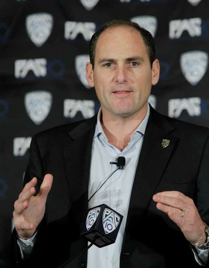 FILE - This Oct. 21, 2010, file photo shows Pac-10 commissioner Larry Scott announcing the splitting of NCAA college football divisions during a news conference in San Francisco. The Pac-10 agreed to a 12-year television contract with Fox and ESPN on Tuesday, May 3, 2011,  that will more than triple its media rights fees and be the most valuable for any conference in college sports.(AP Photo/Paul Sakuma, File) Photo: Paul Sakuma / AP2010
