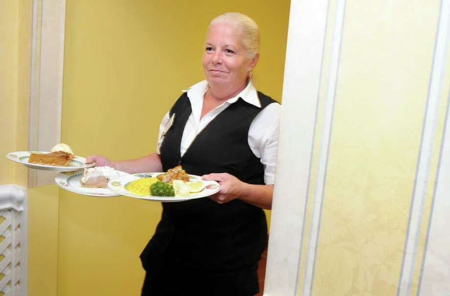 Donna Gasper serves lunch Wednesday, Sept. 7, 2011 at Atria Senior Living in Darien.  Atria Darien was named the top workplace among mid-size companies. Photo: Autumn Driscoll / Connecticut Post